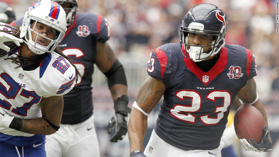 Houston Texans running back Arian Foster looks for daylight against the Buffalo Bills on Sunday at Reliant Stadium in Houston. The Texans won 21-9.