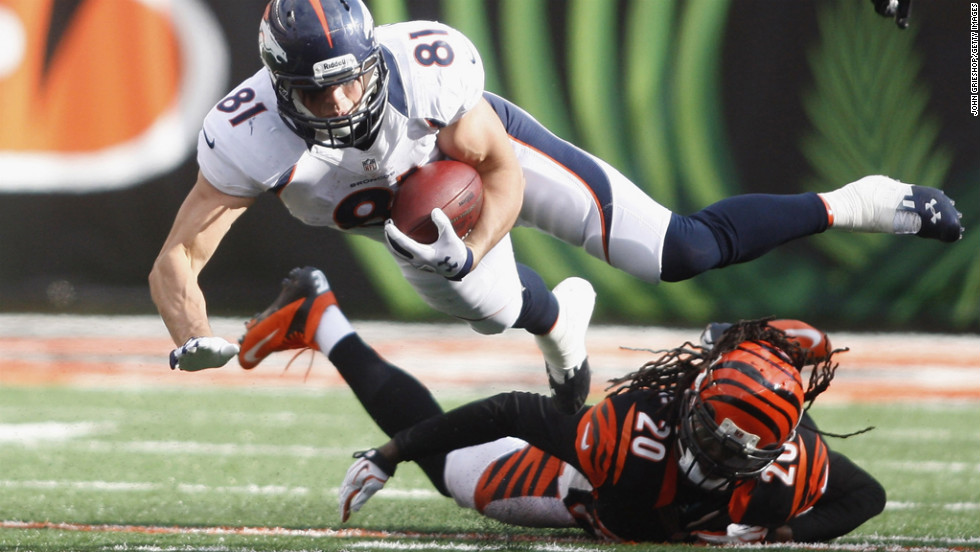Joel Dreessen of the Broncos runs the ball upfield against Reggie Nelson of the Bengals during their game on Sunday.
