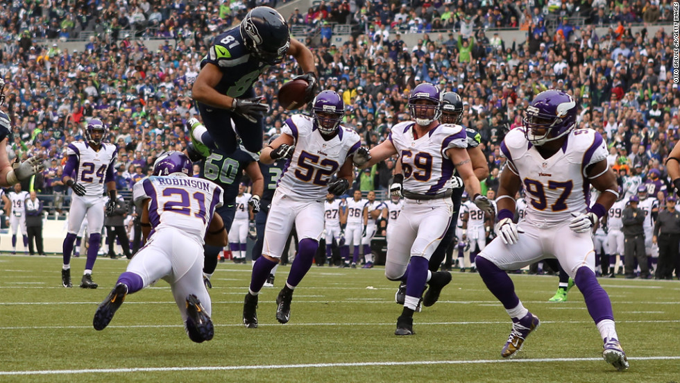 Wide receiver Golden Tate of the Seahawks scores a touchdown against the Vikings on Sunday.
