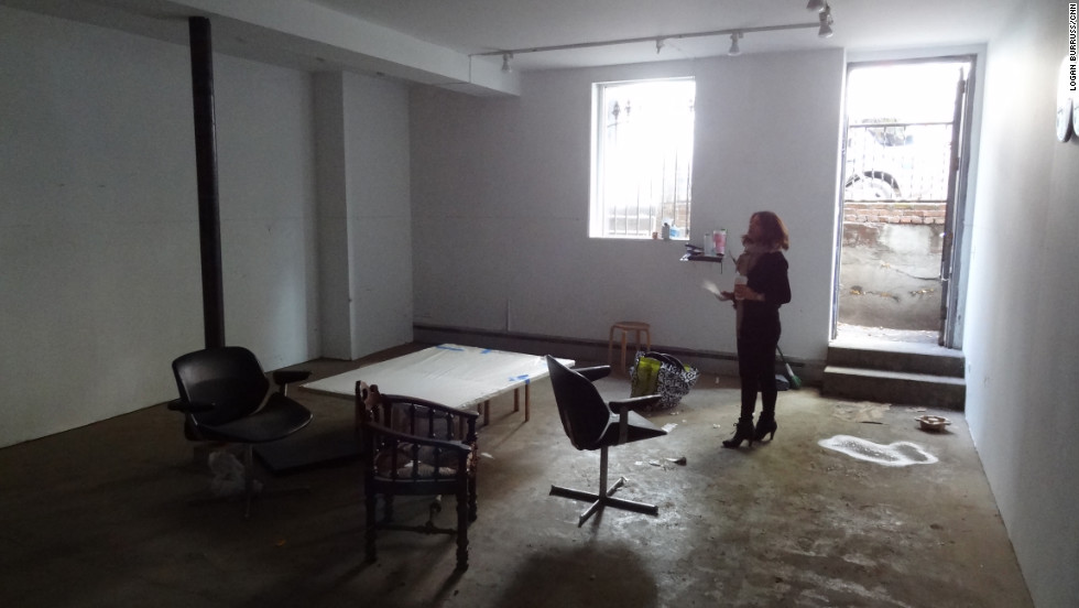 Marisa Newman assesses the flood damage at the Newman Popiashvili Gallery.