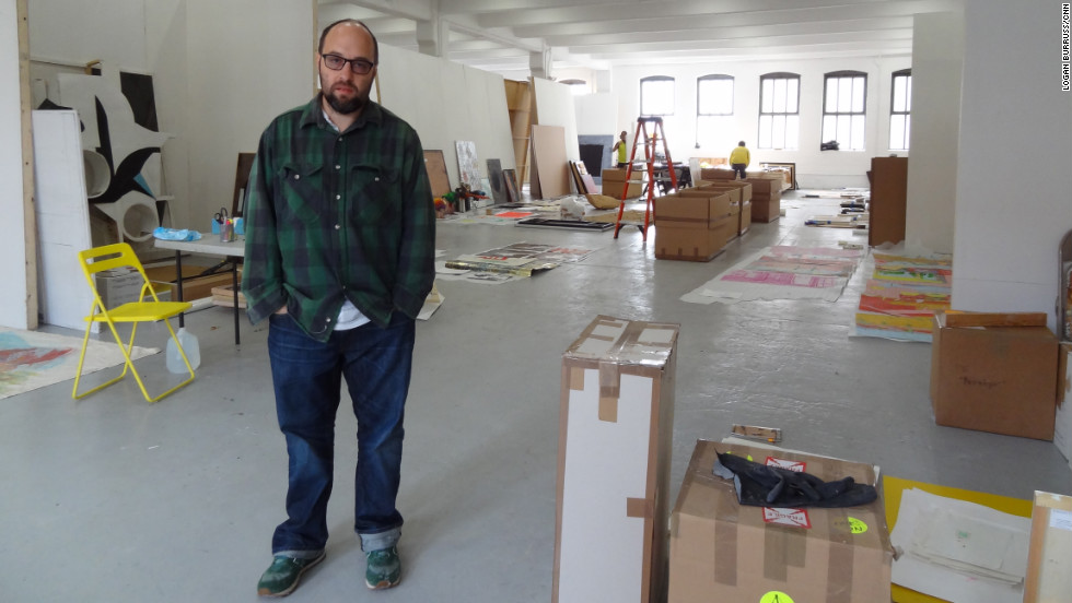 Zach Feuer, temporarily using the floor above his gallery, stands in front of art being salvaged from his space.