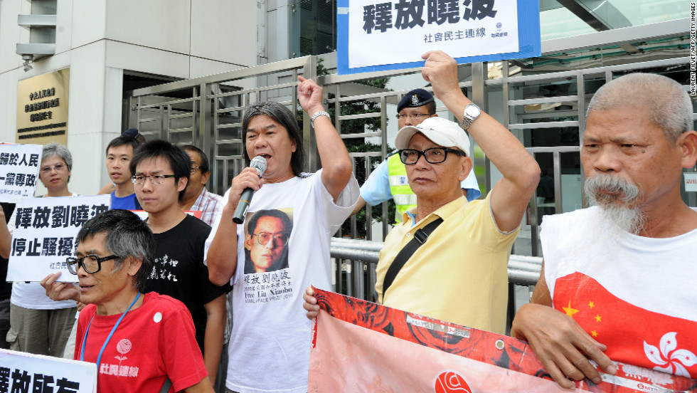 "Hong Kong legislator Leung Kwok-hung (C), also known as ""Long Hair,"" recently demanded for the release of Chinese dissident Liu Xiaobo during a protest outside the Chinese liaison office in Hong Kong -- emphasizing the commitment to free speech in the city."