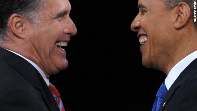 US President Barack Obama (R) greets Republican presidential candidate Mitt Romney (L) following the third and final presidential debate at Lynn University in Boca Raton, Florida, October 22, 2012.