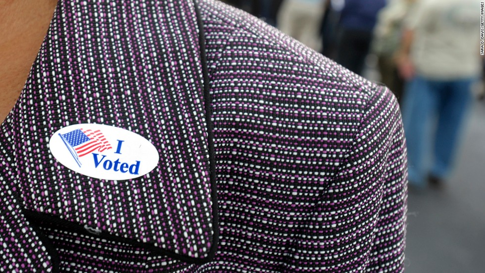 "A voter displays an ""I Voted"" sticker on her lapel after voting early in Wilson, North Carolina, on October 18."