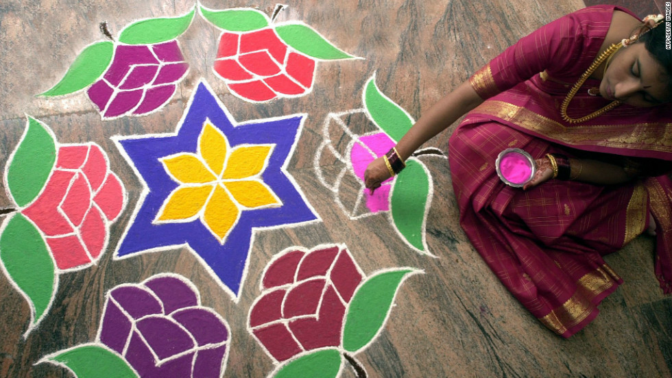 Brightly-colored rangolis are drawn on the ground at the entrances to homes and offices during Diwali, using the fingers and colored flour, rice power, rice grains, flower petals, powders and chalk. They are usually geometric symmetrical designs and symbols of nature such as peacocks, butterflies, animals and flowers.