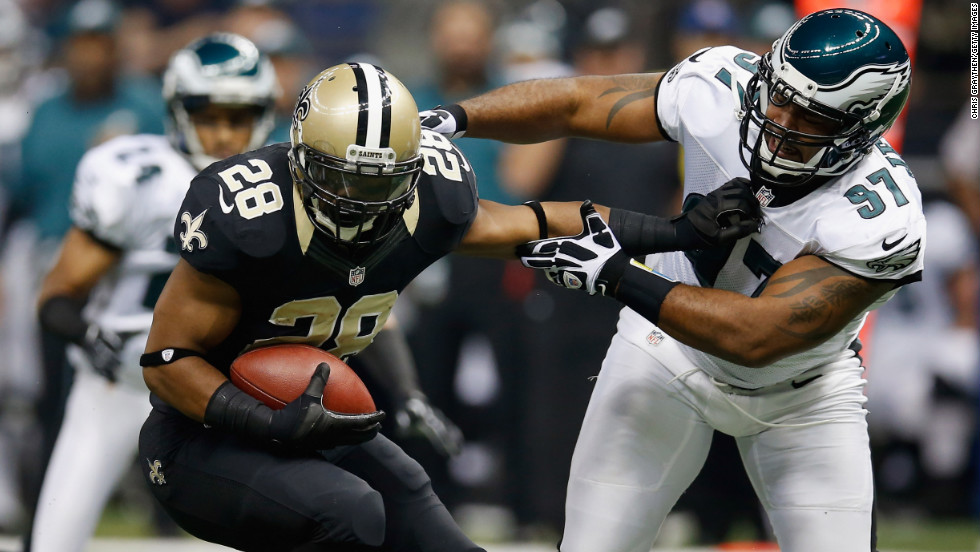 Mark Ingram of the Saints slips a tackle by Eagles defender Cullen Jenkins.