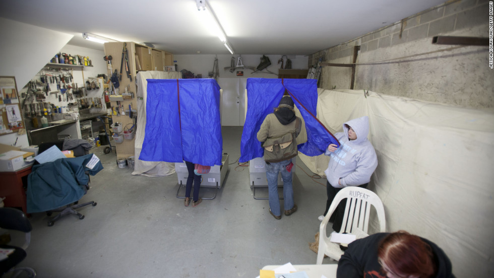 People cast their ballots inside a decorator's garage in South Philadelphia on Tuesday.