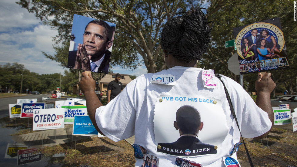 Obama supporter Tonya Lewis rallied for votes outside a polling station in Tampa, Florida.