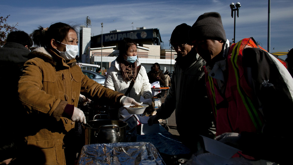 People wait in line for food at a distribution center at Coney Island.