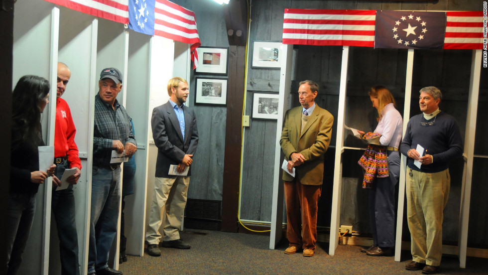 Voters in Dixville Notch, New Hampshire, wait to cast the first Election Day ballots of the U.S. presidential race shortly after midnight. The village has opened polls early since 1960, but for the first time in its history, there was a tie. Obama and Romney each received five votes.
