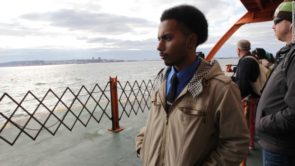 Abraham Cambrelen, 19, takes the Staten Island Ferry to go check on his mother Sunday while New York recovers from Hurricane Sandy.