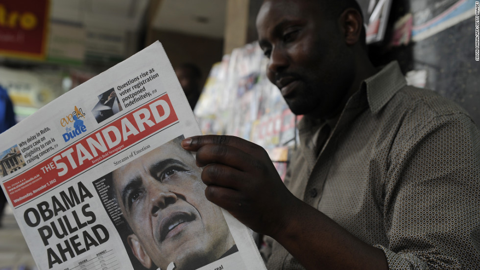 A Kenyan in Nairobi reads the The Standard newspaper headlining Obama's re-election on Wednesday.