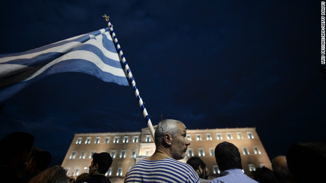 Demonstrators stand in front of the Greek Parliament in Athens on November 7.