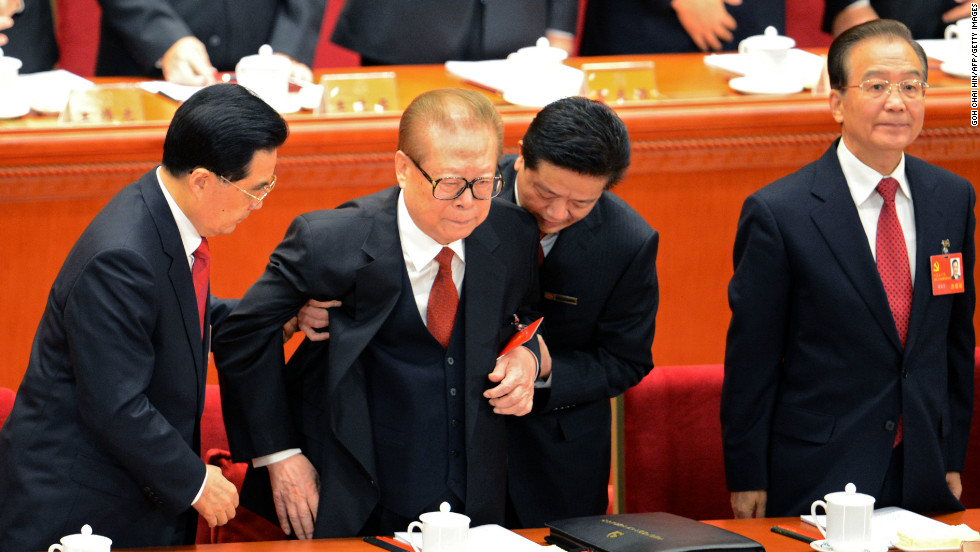 Hu helps former Chinese president Jiang Zemin to stand up as Prime Minister Wen Jiabao looks on at the opening of the 18th Communist Party Congress.