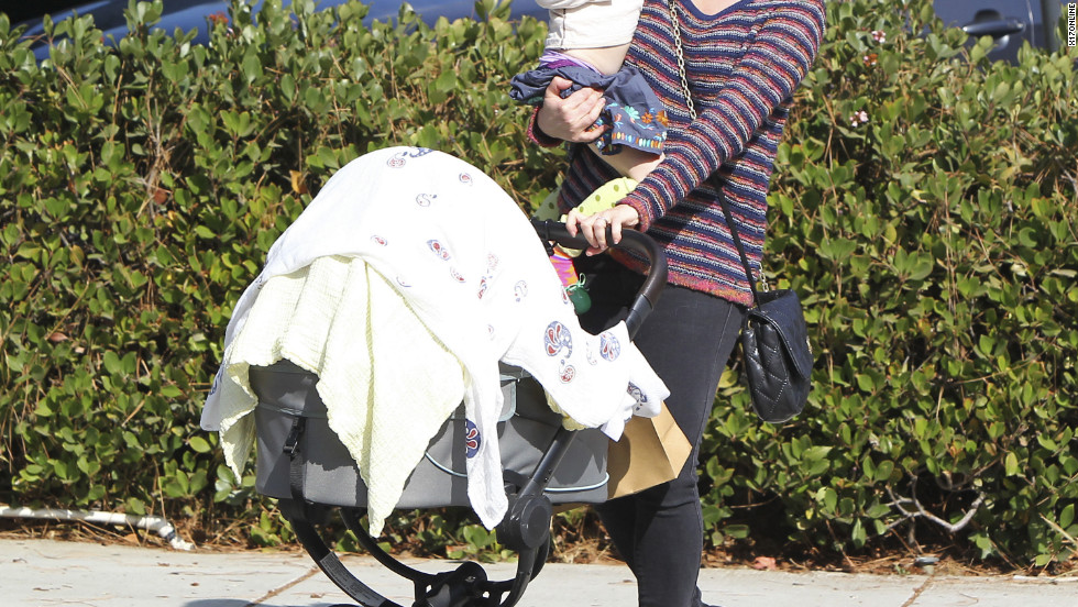 Alyson Hannigan goes for a stroll with her daughters.