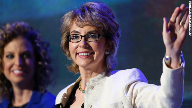 CHARLOTTE, NC - SEPTEMBER 06:  Former U.S. Rep. Gabrielle Giffords (D-NV) walks on stage with Democratic National Committee Chair, U.S. Rep. Debbie Wasserman Schultz (D-FL) during the final day of the Democratic National Convention at Time Warner Cable Arena on September 6, 2012 in Charlotte, North Carolina. The DNC, which concludes today, nominated U.S. President Barack Obama as the Democratic presidential candidate.  (Photo by Joe Raedle/Getty Images)