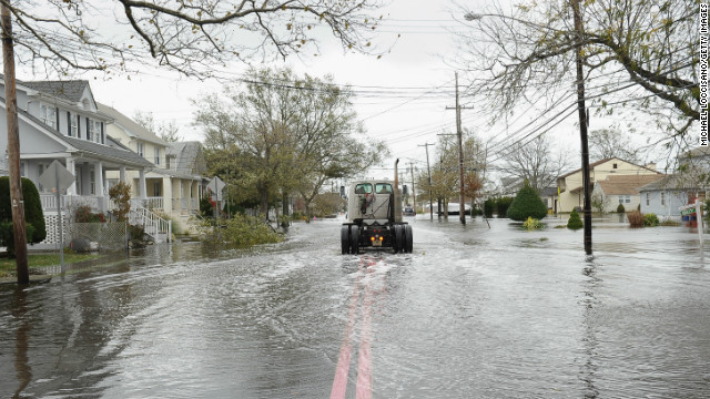 A  truck drives through a neighborhood flooded by Hurricane Sandy in Point Pleasant Beach, New Jersey.