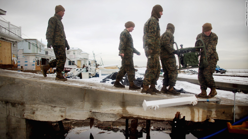 "U.S. Marines from the 8th Engineer Support Battallon out of Camp Lejeune, North Carolina, move a generator to pump out floodwater from a street after a nor'easter on Thursday, November 8, in the Breezy Point neighborhood of Queens, New York. The nor'easter, which dumped 2 feet of snow in some places, complicates Superstorm Sandy recovery efforts. That storm killed at least 111 people in the region and knocked out power to millions of customers.  <a href=""http://www.cnn.com/2012/10/30/us/gallery/sandy-damage/index.html"" target=""_blank"">See photos of the aftermath of Sandy</a>."
