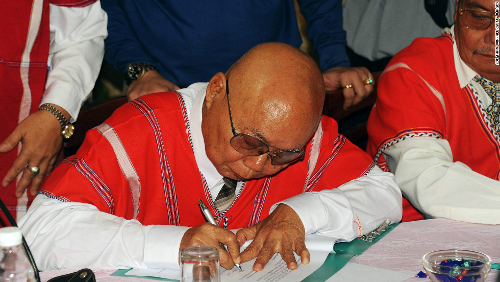 A representative of the rebel Karen National Union (KNU) signs a document during ceasefire talks with a Myanmar government delegation in  Karen state. Myanmar's government and the KNU, one of the country's leading ethnic rebel groups, signed a ceasefire on January 12, raising hopes of an end to one of the world's longest-running civil conflicts.