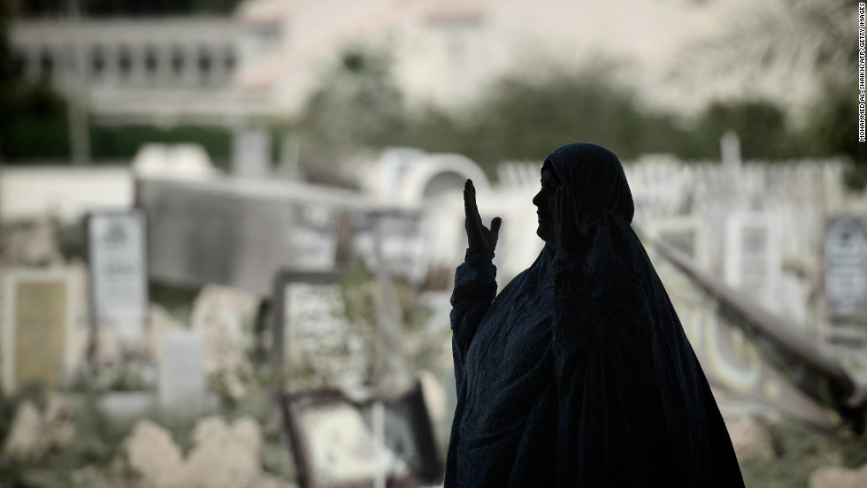 A Bahraini Shiite woman performs her weekly Friday prayers in the village of Diraz, west of Manama.