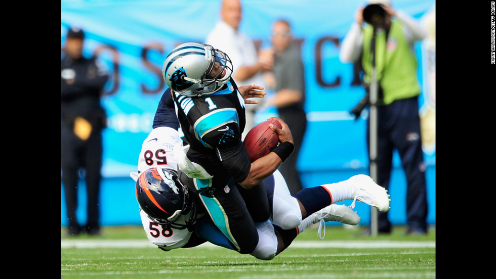 Von Miller of the Broncos sacks Cam Newton of the Panthers on Sunday.