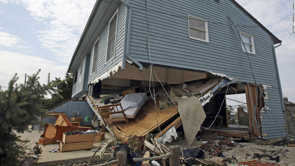 Furniture and other belongings are strewn under and around a beach house damaged by Sandy on Saturday, November 10, in Mystic Island, New Jersey.