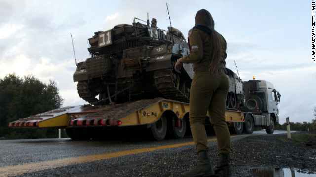 An Israeli soldier overlooks a tank relocation in Alonei Habashan in the Israeli-occupied Golan Heights, on November 11, 2012.