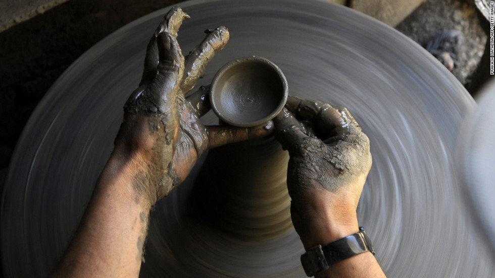 A potter makes earthenware oil lamps in preparation for the Hindu Festival of Lights that the Nepalese call Tihar in Bhaktapur, on the outskirts of Kathmandu.