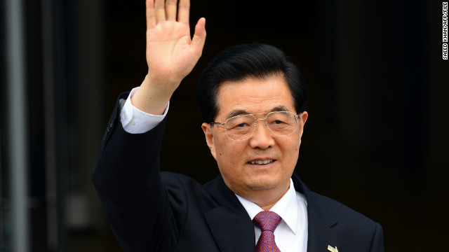 Chinese President Hu Jintao waves as he arrives to attend the Asia-Pacific Economic Cooperation (APEC) summit in Russia's far eastern port city Vladivostok on September 8, 2012.