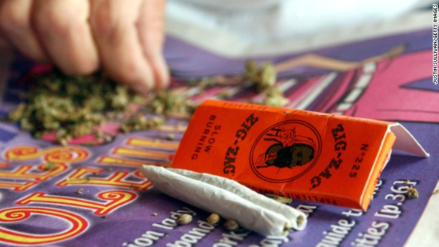 A woman hand rolls joints in San Francisco for a medical cannabis cooperative.