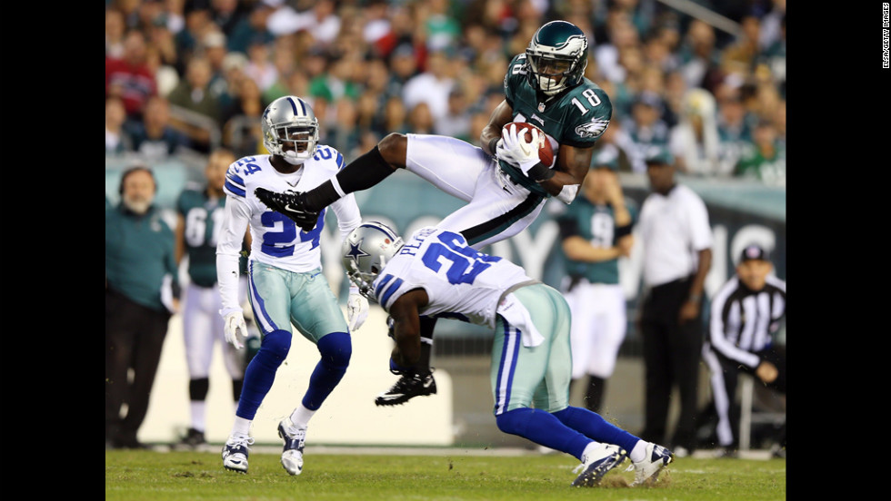 Jeremy Maclin of the Philadelphia Eagles goes up for the catch but does not hang on to the ball as he is hit by Charlie Peprah of the Dallas Cowboys on Sunday at Lincoln Financial Field in Philadelphia.