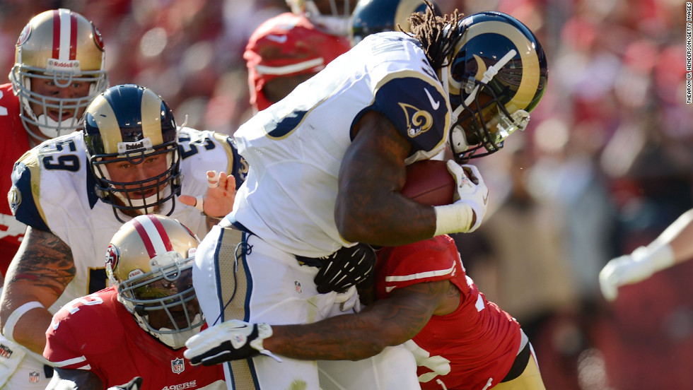 Steven Jackson of the St. Louis Rams drags Dashon Goldson and Patrick Willis of the San Francisco 49ers into the end zone for a seven-yard touchdown run in the first quarter of their game at Candlestick Park on Sunday in San Francisco.