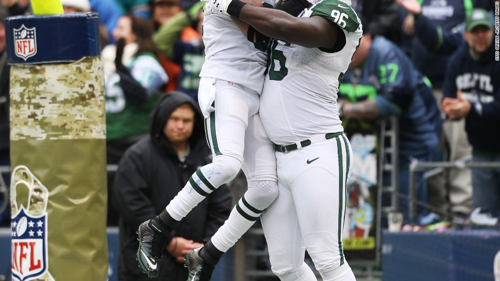 Defensive end Muhammad Wilkerson, right, of the New York Jets celebrates with strong safety Yeremiah Bell after returning a fumble for a touchdown on Sunday.