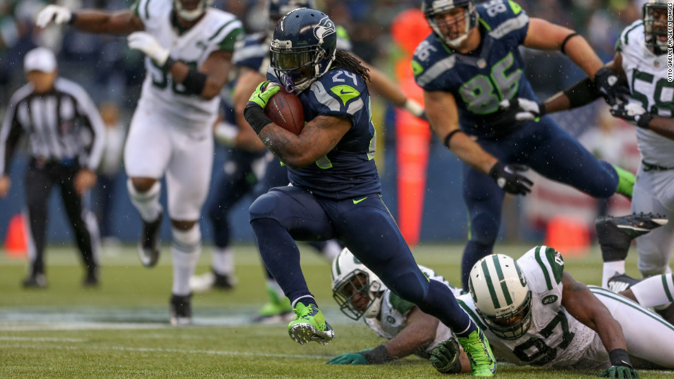 Running back Marshawn Lynch of the Seahawks rushes against the Jets on Sunday.