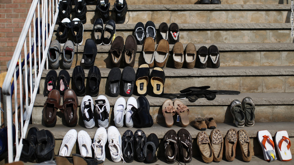 Shoes are set out to dry Monday on the steps of a house in an area that was completely flooded on the south side of Staten Island in New York City.