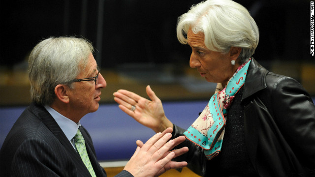Eurogroup Council President Jean-Claude Juncker, left, speaks with IMF Chief Christine Lagarde on October 8.
