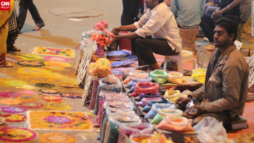 "This brightly colored photo was taken by <a href=""http://ireport.cnn.com/people/manishkanoji"">Manish Kanojia</a> in the ""happening"" Sector 18 of the Noida district in New Delhi. The colored sand on sale is for making Rangolis, decorative floor designs made to welcome guests and encourage the goddess Lakshmi inside during Diwali. ""Most people buy the sand and make their own, or they buy readymade stencils,"" Kanojia says."