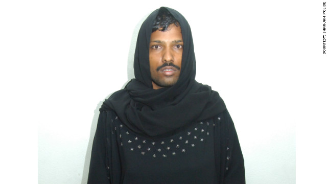 A mug shot of a man who dressed like a woman to sneak into a ladies only park in the UAE.