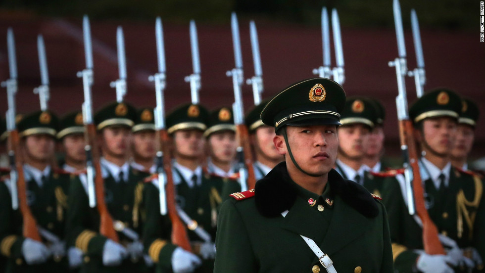 A paramilitary police officer stands guard during the flag-lowering ceremony at  Tiananmen Square on November 13.