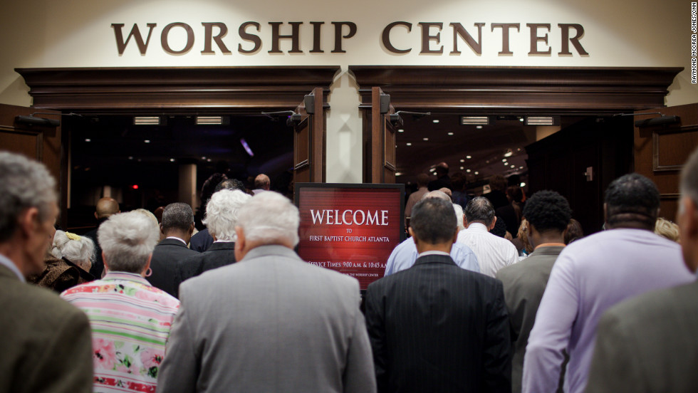 Churchgoers wait outside the entrance to First Baptist Church Atlanta on a recent Sunday morning. Service began at 9 a.m. but people began lining up at 7:30 a.m. The church is Southern Baptist but its appeal transcends denominational and racial lines.