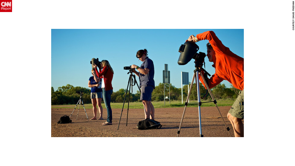 "<a href=""http://www.flickr.com/photos/8547591@N08/"" target=""_blank"">David Freeman</a> of Longreach in outback Queensland sent in this image of photographers prepping for the big moment. ""Even if we didn't get totality the light was really interesting,"" he says. ""Coming so close after sunrise we had the typical outback orange and red sunrise and then went into an almost surreal subdued light. Not the same colors as a normal sunrise but definitely not normal daylight either."""
