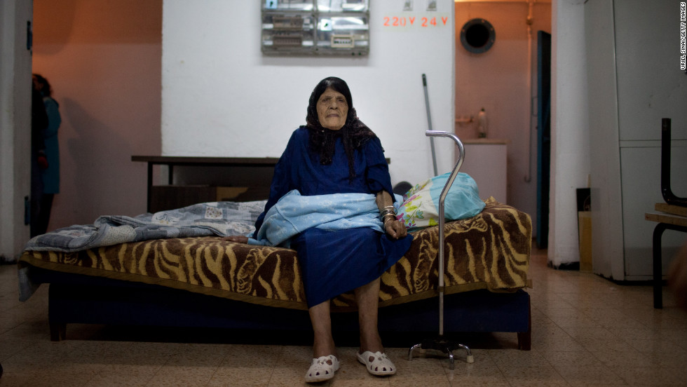 A woman sits inside a bomb shelter Wednesday, November 14, in Netivot, Israel.