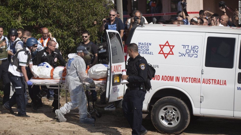 Rescue workers evacuate a body Thursday, November 15, in the Israeli town of Kiryat Malakhi after a rocket launched from Gaza hit an apartment building.