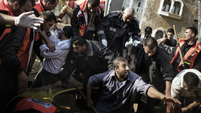 A man calls for help as he and others try to save a trapped man after an Israeli air raid in the northern Gaza town of Beit Lahia.