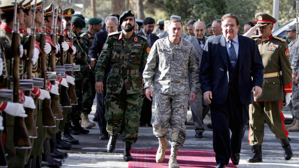 At the end of October, Petraeus was advanced to Commander of Central Command. Pictured, Petraeus and Afghan Defense Minister Gen. Abdul Rahim Wardak inspect an Afghan Guard of Honor at the Defense Ministry in Kabul on November 5, 2008. Petraeus arrived in Kabul to assess efforts against insurgents in the start of his new job, the U.S. military said.