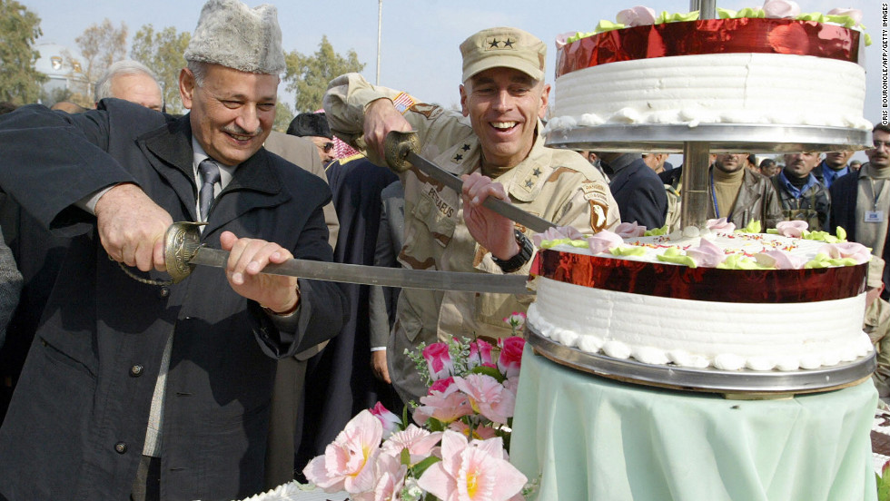 Provincial Governor Ghanem al-Basso, left, commemorates the 83rd anniversary of the establishment of the Iraqi army with Petraeus and the graduation of its new 2nd Battalion in Mosul, Iraq.