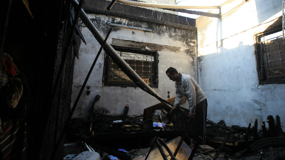 A Palestinian man inspects his damaged house following an Israeli airstrike early Thursday, November 15, in Gaza City.