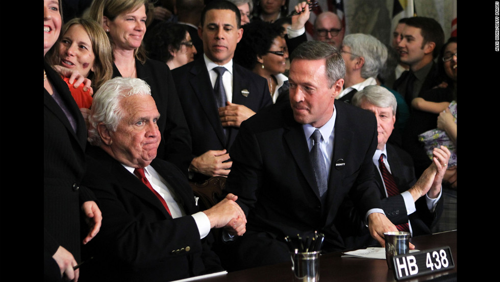 "On March 1, 2012, Maryland Gov. Martin O'Malley, center, shakes hands with Senate President Thomas V. ""Mike"" Miller after signing a same-sex marriage bill. The law was challenged, but voters approved marriage equality in a November 2012 referendum."