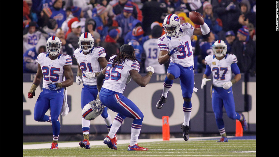 Jairus Byrd jumps in the air as his Buffalo Bills teammates celebrate his fourth-quarter interception against the Miami Dolphins at Ralph Wilson Stadium on Thursday, November 15, in Orchard Park, New York. Buffalo won the game 19-14.