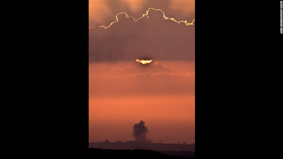 A picture taken from the southern Israeli border with Gaza shows smoke billowing following an Israeli air strike inside the Palestinian territory on Saturday, November 17. Turkish Prime Minister Recep Tayyip Erdogan said that Israel would be held to account for the children who were among 40 people dead in three days of airstrikes on Gaza.
